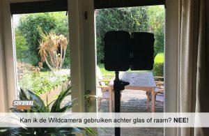 Kan ik de Wildcamera gebruiken achter glas of raam? NEE!